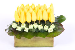 Yellow tulips decoration. Yellow tulips table decoration in flowerpot royalty free stock images