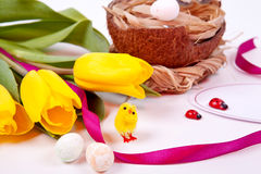 Yellow tulips and Easter eggs stock photos