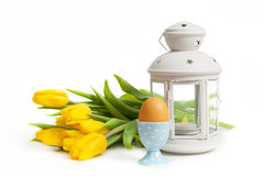 Yellow tulips, egg and lantern Stock Photography