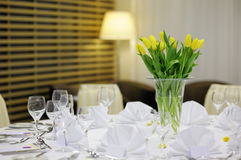 Yellow tulips on a festive table Stock Image