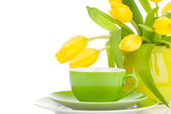 Yellow tulips flowers with cup tea, Stock Photography