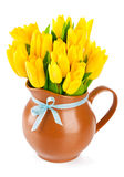 Yellow tulips flowers in jug Stock Images