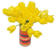 Yellow tulips flowers in a vibrant colored vase, close up, isolated, white background Royalty Free Stock Images
