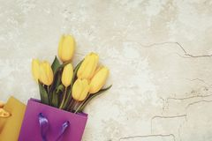 Yellow tulips in gift paper bag Royalty Free Stock Image