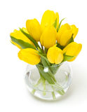 Yellow tulips in a glass vase Royalty Free Stock Photos