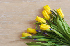 Yellow tulips  lying on wood Stock Photos