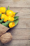 Yellow tulips over wooden table Royalty Free Stock Image