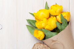 Yellow tulips over wooden table Stock Photos