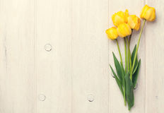 Yellow tulips over wooden table Stock Photography