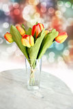 Yellow tulips on the table. Royalty Free Stock Images