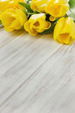 Yellow tulips on a table Royalty Free Stock Photos
