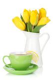 Yellow tulips and tea cup with lemon slice Stock Photography