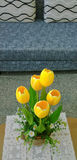 Yellow tulips in a vase. Yellow tulips in a vase on the table in the living room royalty free stock images