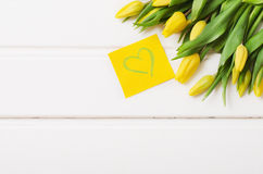 Yellow tulips on white boards.  Royalty Free Stock Image