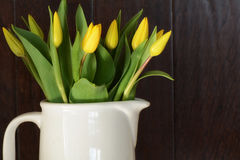 Yellow tulips in white jug Stock Photography