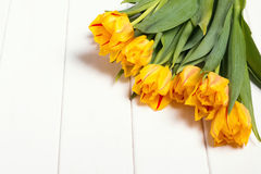 Yellow tulips on the white table Royalty Free Stock Image