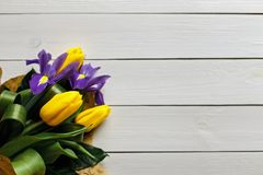 Yellow tulips on a white wooden background Stock Image