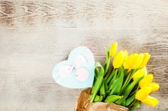Yellow tulips on wooden background. Yellow tulips on wood background Royalty Free Stock Photos