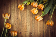 Yellow tulips on wooden background. Toned, top view, copy space Royalty Free Stock Image
