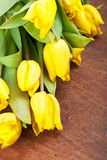 Yellow tulips on a wooden Stock Photo