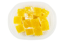 Yellow Turkish delight in transparent plastic box Stock Images