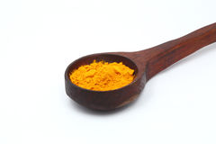 Yellow turmeric in wooden spoon,Ground turmeric on wooden spoon Stock Photography