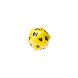 Yellow twenty sided dice for board games Stock Photo