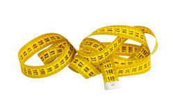 Yellow twisted measuring tape. Isolated on white Royalty Free Stock Photo