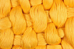 Yellow twisted skeins of floss as background texture Royalty Free Stock Photos