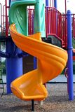 Yellow Twisty Slide. A yellow twisty slide on a playground Royalty Free Stock Photography