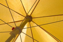 Yellow Umbrella. View of the yellow umbrella from the inside Stock Photography