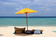 Yellow umbrella. On the beach, Phi Phi island, Thailand stock image