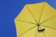 Yellow umbrella Stock Images