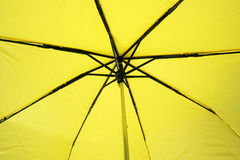 Yellow Umbrella. From the underside royalty free stock photos