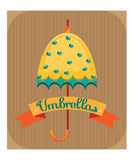 Yellow umbrella with blue hearts Stock Images