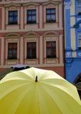 Yellow umbrella and colorful walls at male Namesti Stock Photos
