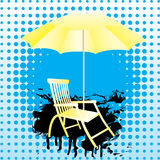 Yellow umbrella and deckchair. Royalty Free Stock Photo