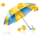 Yellow umbrella with falling leaves Royalty Free Stock Image