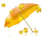 Yellow umbrella with falling leaves Royalty Free Stock Photos