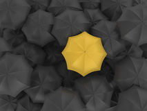 Yellow Umbrella with Many Black Ones - Individuality Concept Stock Images
