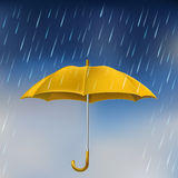 Yellow umbrella in rain Stock Image