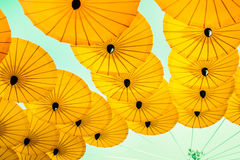 Yellow umbrella showing scenery in the park Royalty Free Stock Photography