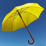 Yellow umbrella on the sky Royalty Free Stock Photo