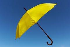Yellow umbrella on the sky Royalty Free Stock Photos