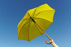 Yellow umbrella on the sky Royalty Free Stock Photography