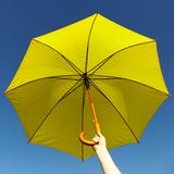 Yellow umbrella on the sky Stock Photo