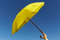 Yellow umbrella on the sky Royalty Free Stock Image