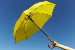 Yellow umbrella on the sky Stock Photos