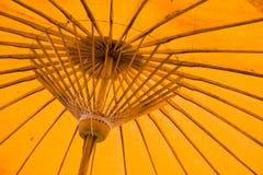 Yellow umbrella structure pattern. Closeup of red handmade umbrella structure pattern Stock Images