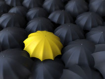 Free Yellow Umbrella Surrounded By Black Umbrellas Stock Photos - 10277003